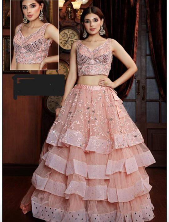 Gorgeous Peach Net Fabric Crop Top And Skirt